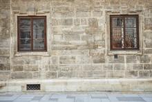 Window With Metal Lattice Black With Gray Stone Wall
