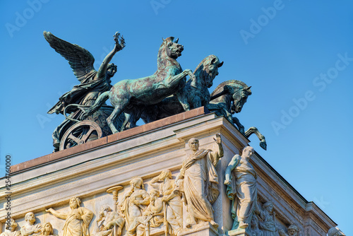 Fényképezés  Allegoric sculptural decor on the roof of building of Austrian Parliament, in Vienna