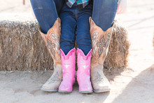 Child Wearing Pink Cowboy Boot...