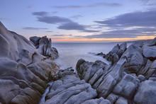 Italy, Sardinia, Granite Rocks On Coast At Sunrise At Capo Testa