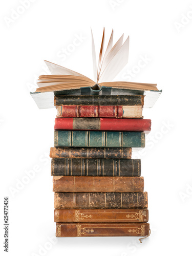 Fotografía  Large books pile with single open book isolated with clipping path