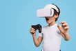 canvas print picture Amazed kid in VR headset playing game