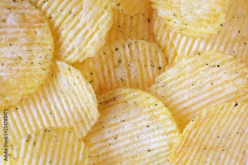 Fotografie, Obraz  Golden wavy chips close-up