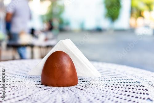 Fotografie, Obraz  Closeup of napkin holder on vintage table in cafe restaurant outdoors outside pa