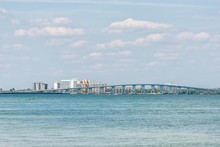 Sanibel Island, USA Bay During Sunny Day With Toll Bridge Causeway Bridge Highway Road And Cars In Traffic Holiday Vacation Destination In Florida People Swimming
