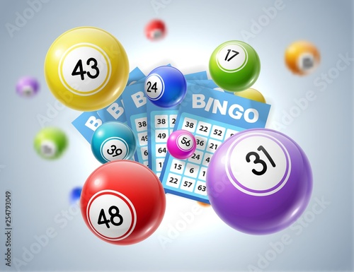 Photo Lotto balls and lottery tickets with numbers