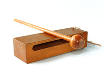 Woodblock And Mallet Musical Instrument On A White Background