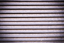 Horizontal Stripes Of Dusty Metal Jalousie Exterior With Vignette. Background, Texture.
