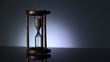 Time Lapse of Sand Flowing Through vintage metal hourglass on grey background