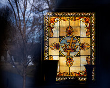 Stained Glass Window With Christian Cross.
