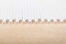 Row Of Paper Straws Laying On A Wood Table. Ecologically Friendly Yet Durable Paper Drinking Straws. A Ban On Plastic Straws In Restaurants And Other Service Businesses Began In Washington, D.C.