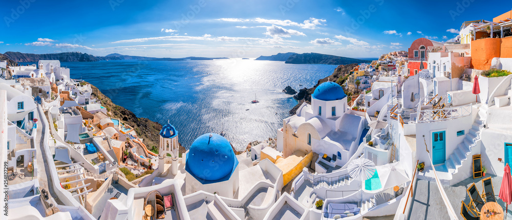 Fototapeta Sunset on the famous Oia city, Greece, Europe