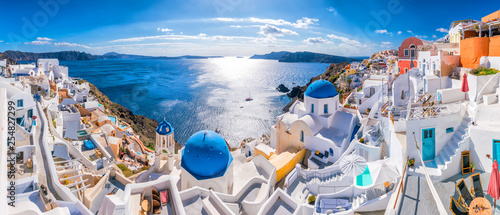 Fotografia  Sunset on the famous Oia city, Greece, Europe