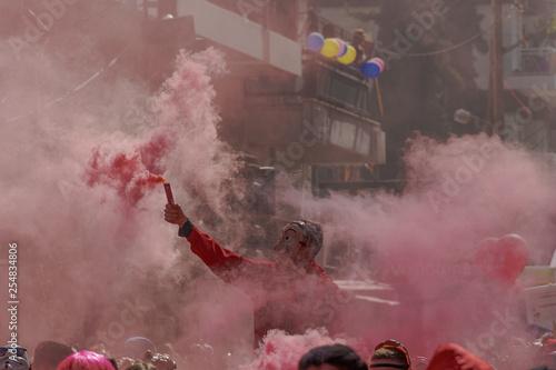 Fotografía  Xanthi, Greece Carnival parade participant with Casa De Papel costume hold flare