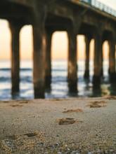 Sand With Tracks Near Manhattan Beach Pier In Los Angeles
