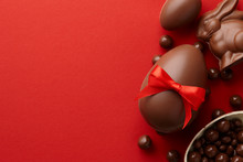 Easter Composition With Chocolate Eggs And Bunny On Red Background, Holiday Concept