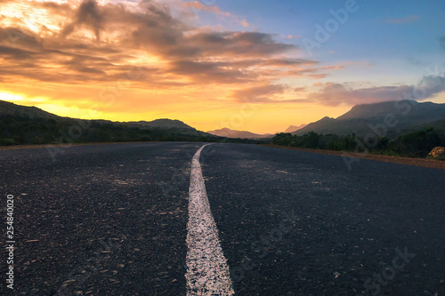 Foto auf Leinwand Grau Verkehrs Countryside Road, Scenic road highway over rural hills countryside on sunset at soth africa