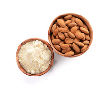 Bowls With Almonds And Flour On White Background