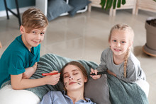 Little Children Drawing On Face Of Their Sleeping Mother. April Fools' Day Prank
