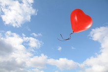 Red Heart Shaped Balloon Flies Into The Blue Sky With Clouds, Love Concept, Copy Space