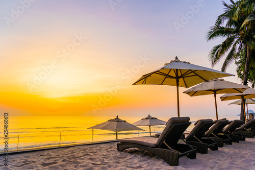 Fototapety, obrazy: Umbrella and chair on the beautiful beach and sea at sunrise time for travel and vacation