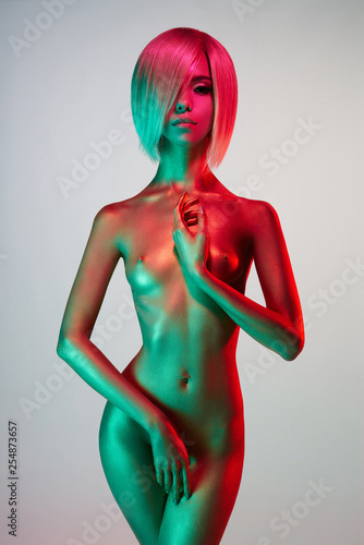Foto auf Leinwand womenART Elegant nude model in the light colored spotlights