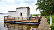 White Wooden Houseboat On Lake Schwerin In Mecklenburg-Vorpommern. Germany