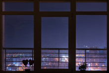 Beautiful Night City View From Cosy Panoramic Window With Rain Drops On It. Kyiv, Ukraine.