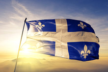 Quebec Province Of Canada Flag Waving On The Top Sunrise Mist Fog