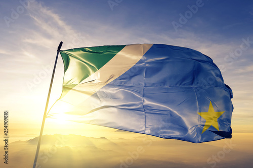 Mato Grosso do Sul state of Brazil flag waving on the top sunrise mist fog Canvas Print