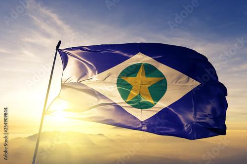 Fotografija  Mato Grosso state of Brazil flag waving on the top sunrise mist fog