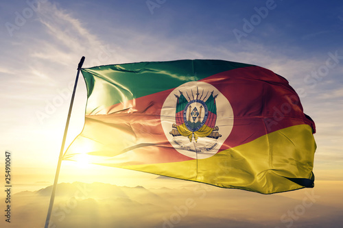 Aluminium Prints Brazil Rio Grande do Sul state of Brazil flag waving on the top sunrise mist fog