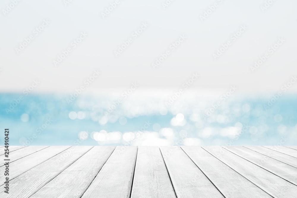 Fototapeta Blurred blue sky and sea with bokeh light