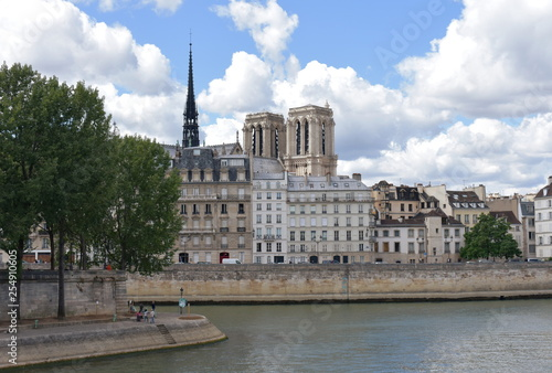 Paris, France. Notre Dame towers and spire from a Seine River bridge, Pont Louis Philippe.
