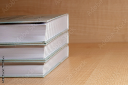 Fotografering  stack of books on wooden background