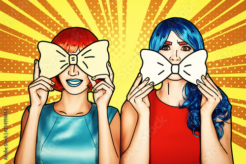 Photo Females in red and blue wigs. Girls with yellow bow-tie in hands