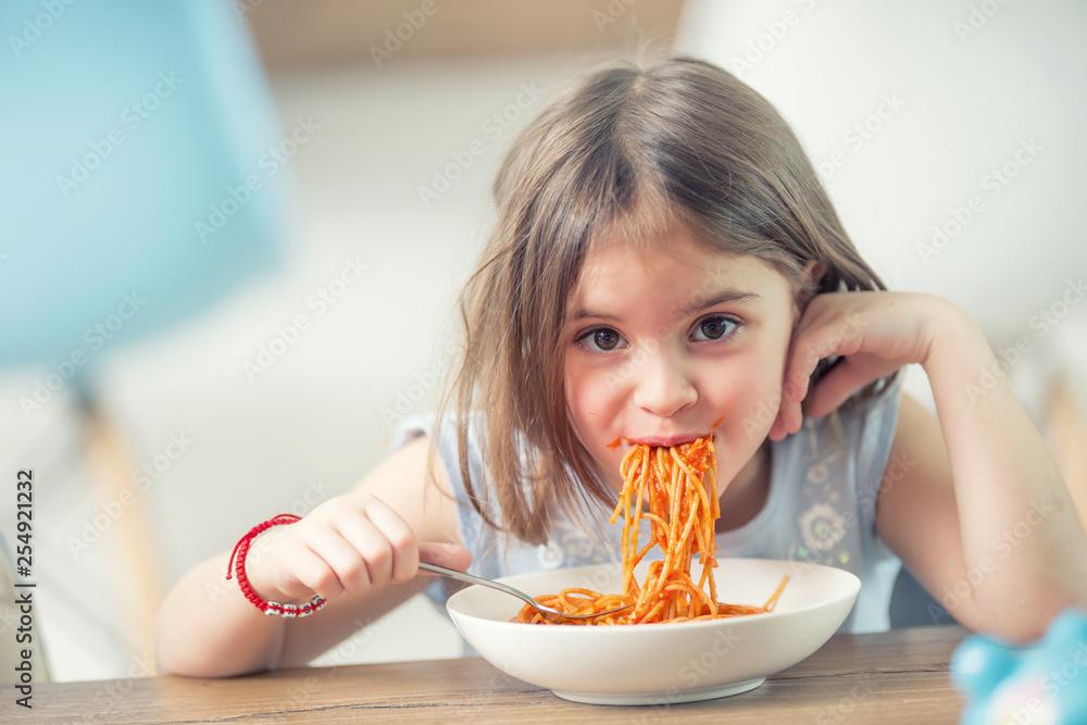 Fototapety, obrazy: Cute little kid girl eating spaghetti bolognese at home