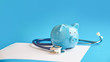 Leinwanddruck Bild - Piggy bank with stethoscope isolated on blue background. concept of financial literacy. Creating and maintaining a budget. keeping their finances on track. ruin loan history