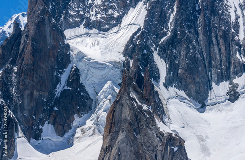 Fotografie, Obraz  Ice snowy seracs and rocks in the upper parts of the Mont Blanc massif