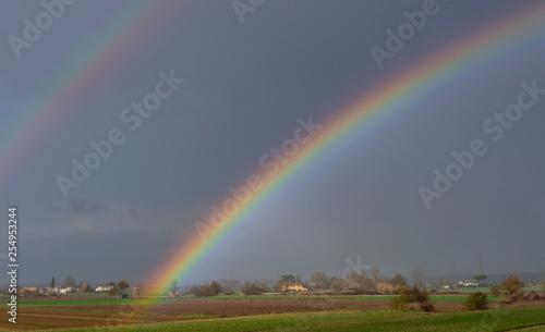 Fotografia  Beautiful rainbow over the countryside of the province of Pisa, Tuscany, Italy,