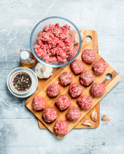 Raw Meatballs Made From Fresh Minced Meat With Spices .