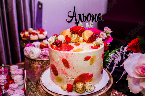Beautiful cake decorated of candies and roses with the inscription Alena Wallpaper Mural