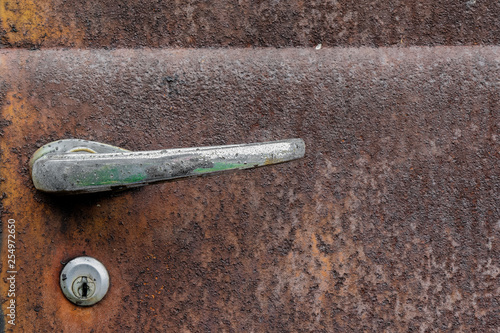 Obraz na plátně Old rusty antique truck and car door with chrome handle
