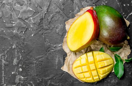 Fragrant ripe mango on a napkin. Fototapeta