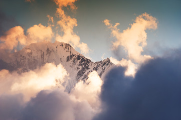Himalaya mountain peaks with clouds at sunset. Nepal