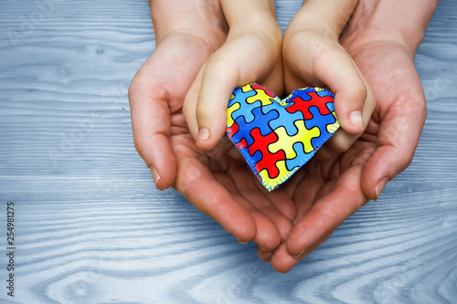 Obraz na plátně  World Autism Awareness day, puzzle or jigsaw pattern on heart with autistic chil