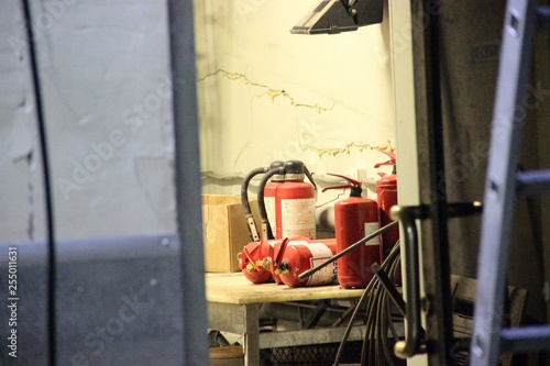 Fotografie, Obraz  Many fire extinguishers on the table in the old pantry, framing