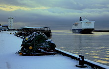 A Ferry Returns Up The River Tyne, Past The Snow Covered Fish Quay At North Shields