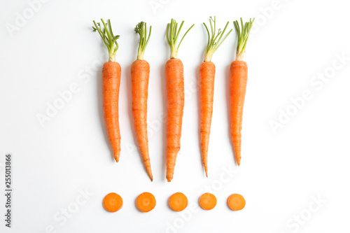 Flat lay composition with ripe fresh carrots on white background Poster Mural XXL