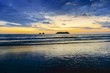 Dramatic Sunset Sky and Stormy Clouds over Pacific Ocean Coastline on Manuel Antonio National Park Beach in Coast Rica